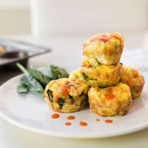 80 day obsession meal plan A buffalo sauce on stack of buffalo chicken egg muffins