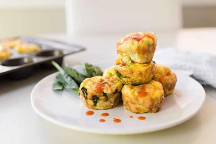 buffalo sauce on stack of egg muffins - Amanda Seghetti