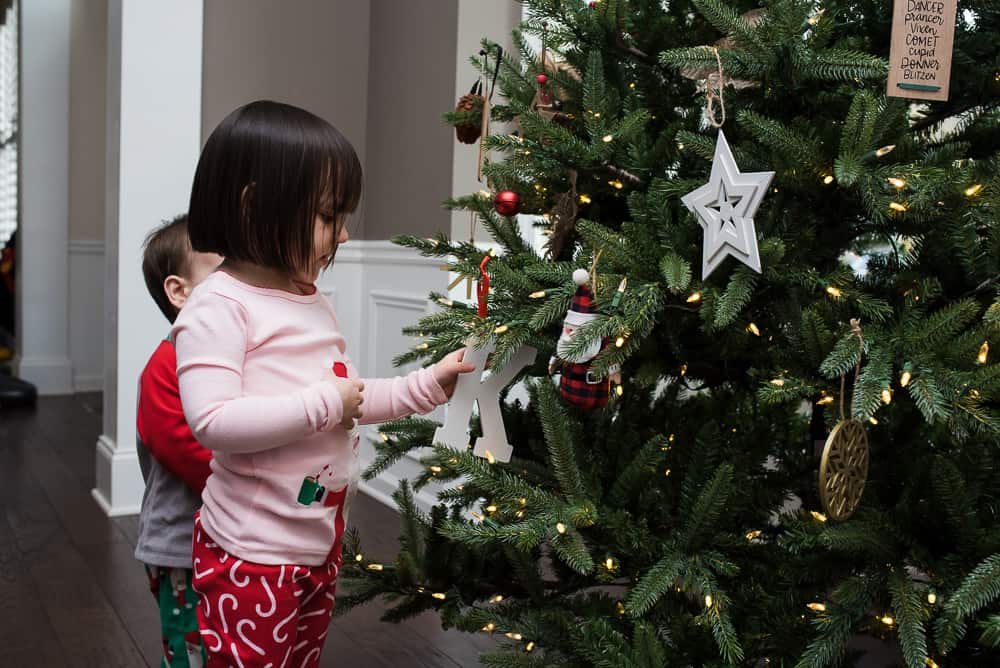 Toddlers decorating Christmas tree