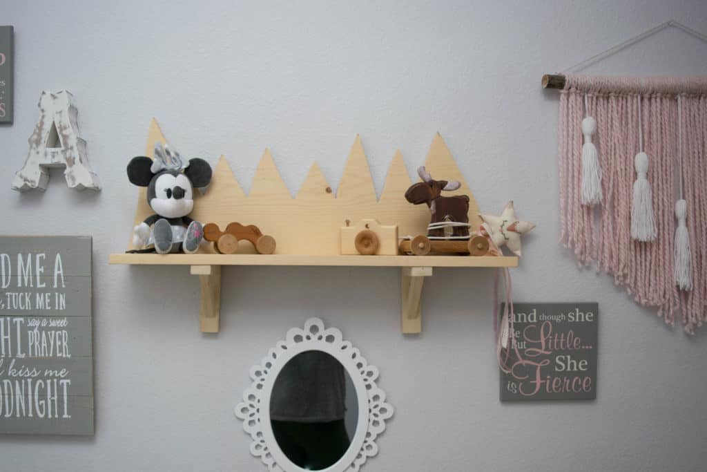 Wooden mountain shelf and decor in DIY mountain nursery