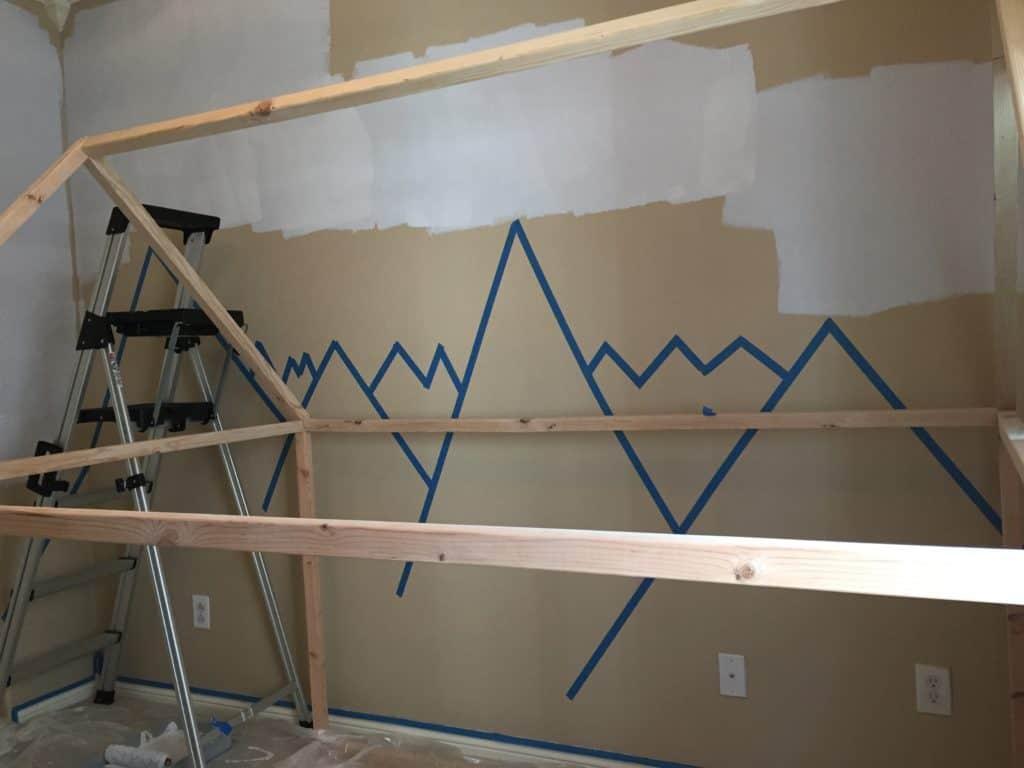 Using painters tape to create mountain peaks for DIY mountain nursery