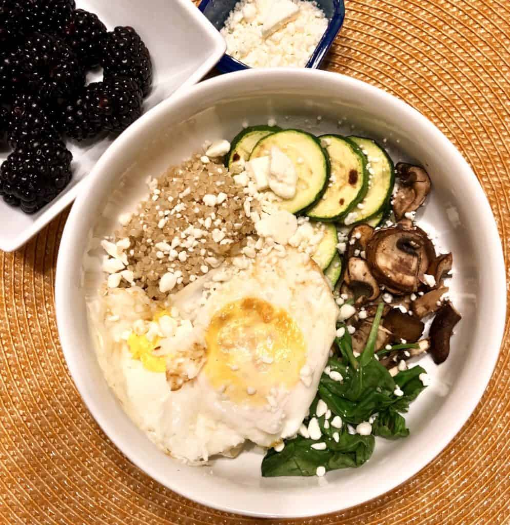 80 day obsession meal 2 quinoa breakfast bowl: 2 eggs, quinoa, spinach, mushrooms, zucchini, feta, and blackberries and PB on the side