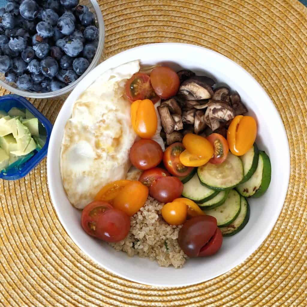80 day obsession meal plans - Meal 2 breakfast quinoa bowl: 2 eggs, quinoa, mushrooms, zucchini, tomatoes, avocado, side of blueberries and PB (meal plan D)