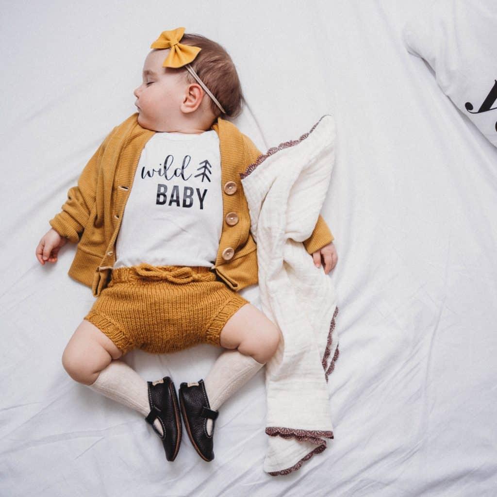 toddler sleeping in bed