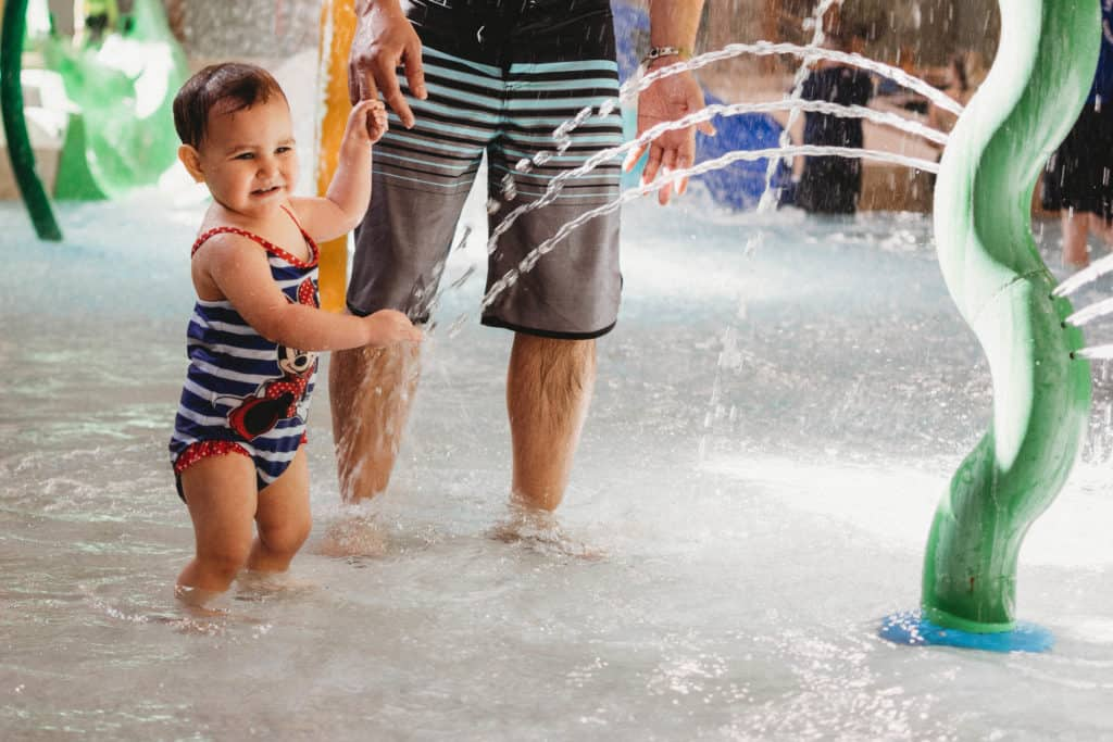 toddler playing in water at Great Wolf Lodge Colorado Springs