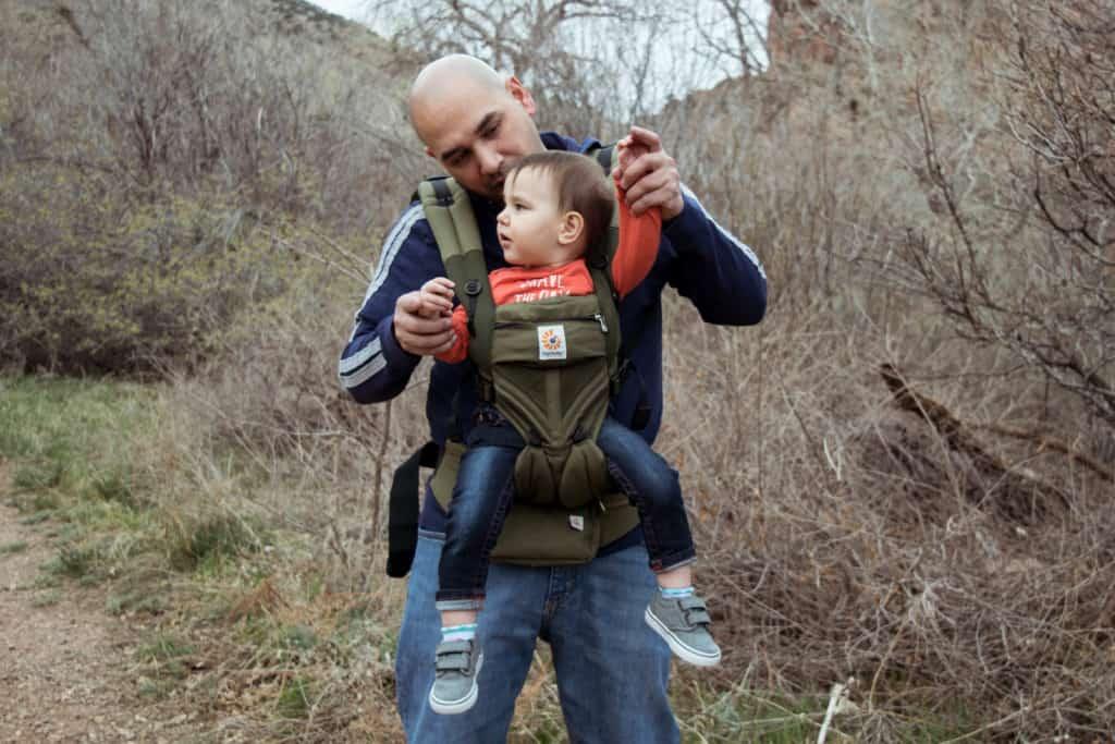 Dad wearing toddler in ergobaby omni 360