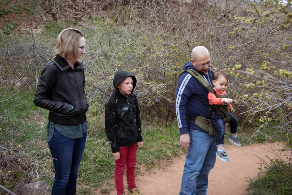 family hiking with baby in Ergobaby carrier
