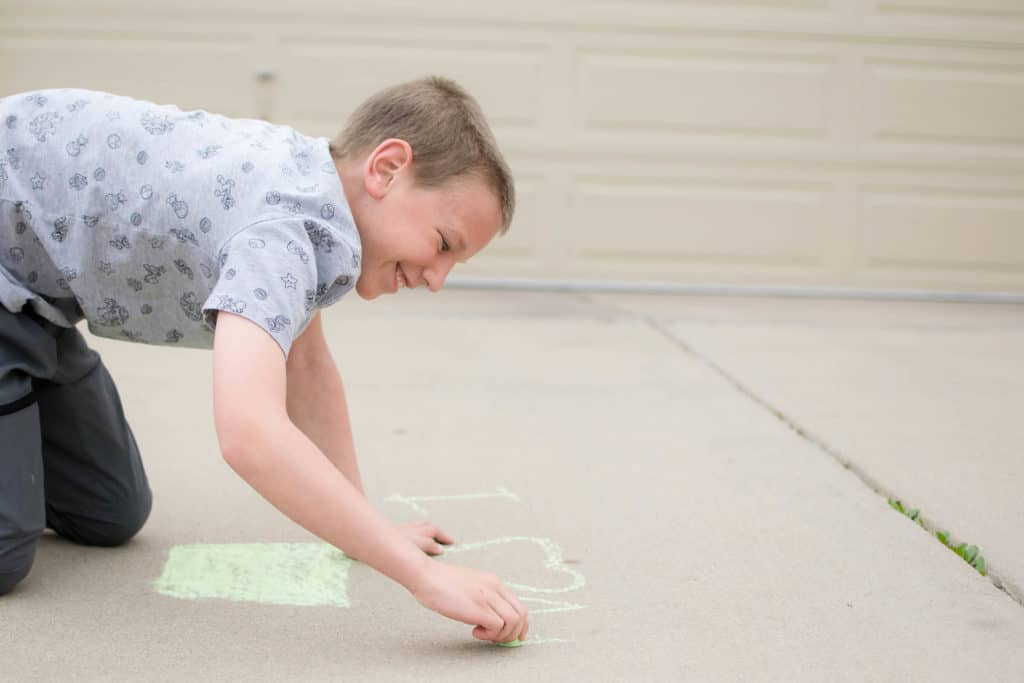 playing hopscotch with sidewalk chalk activities for bored kids