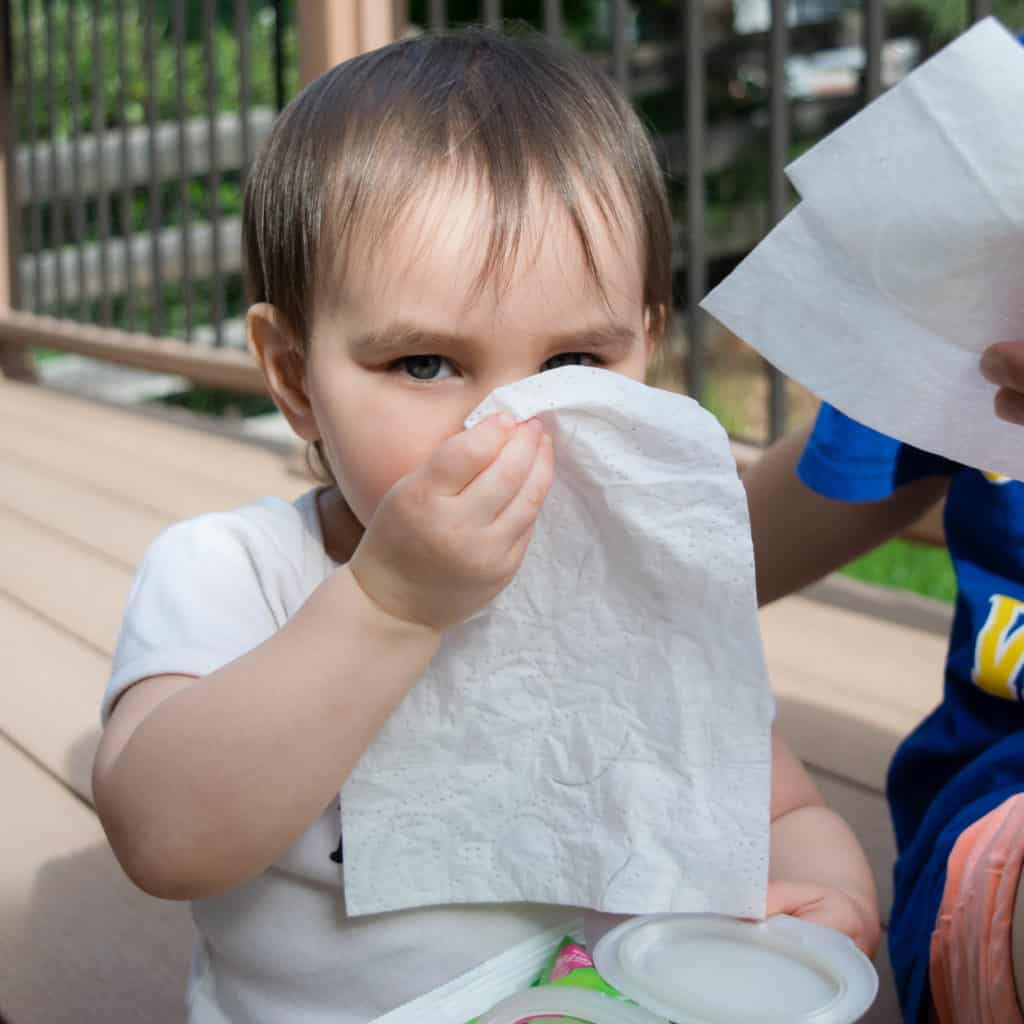 toddler using kleenex wet wipes
