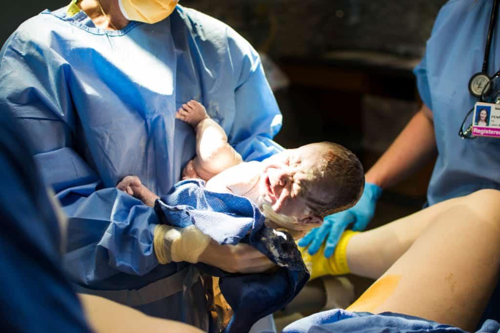 newborn baby boy with vernix