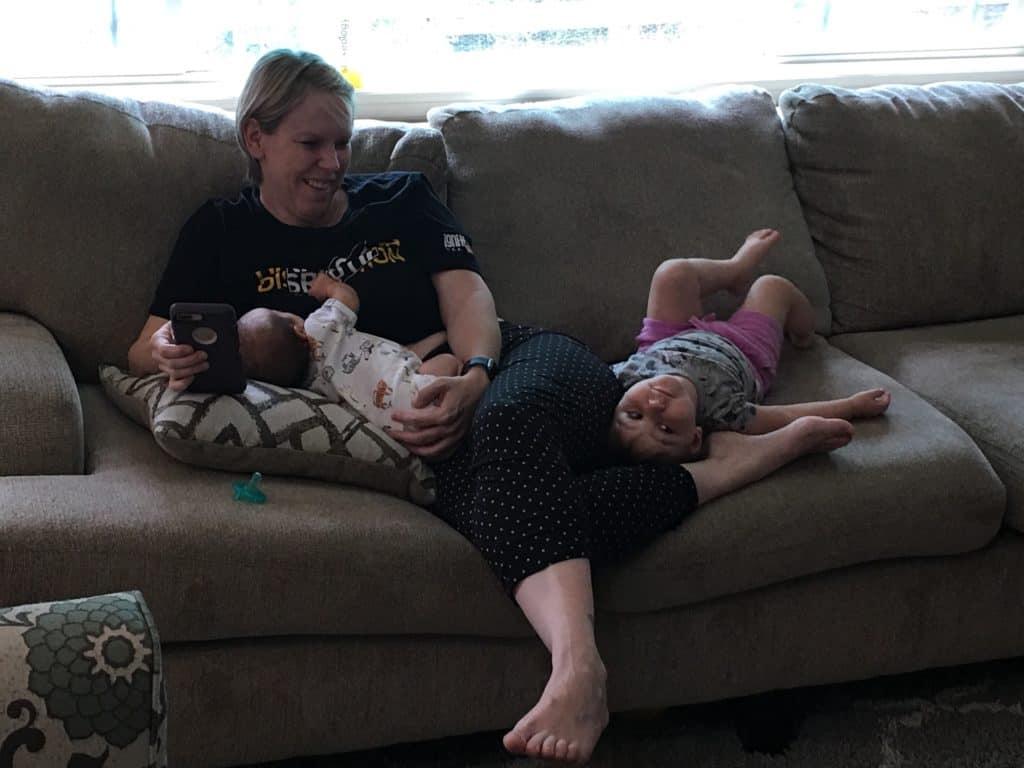 nursing baby with toddler