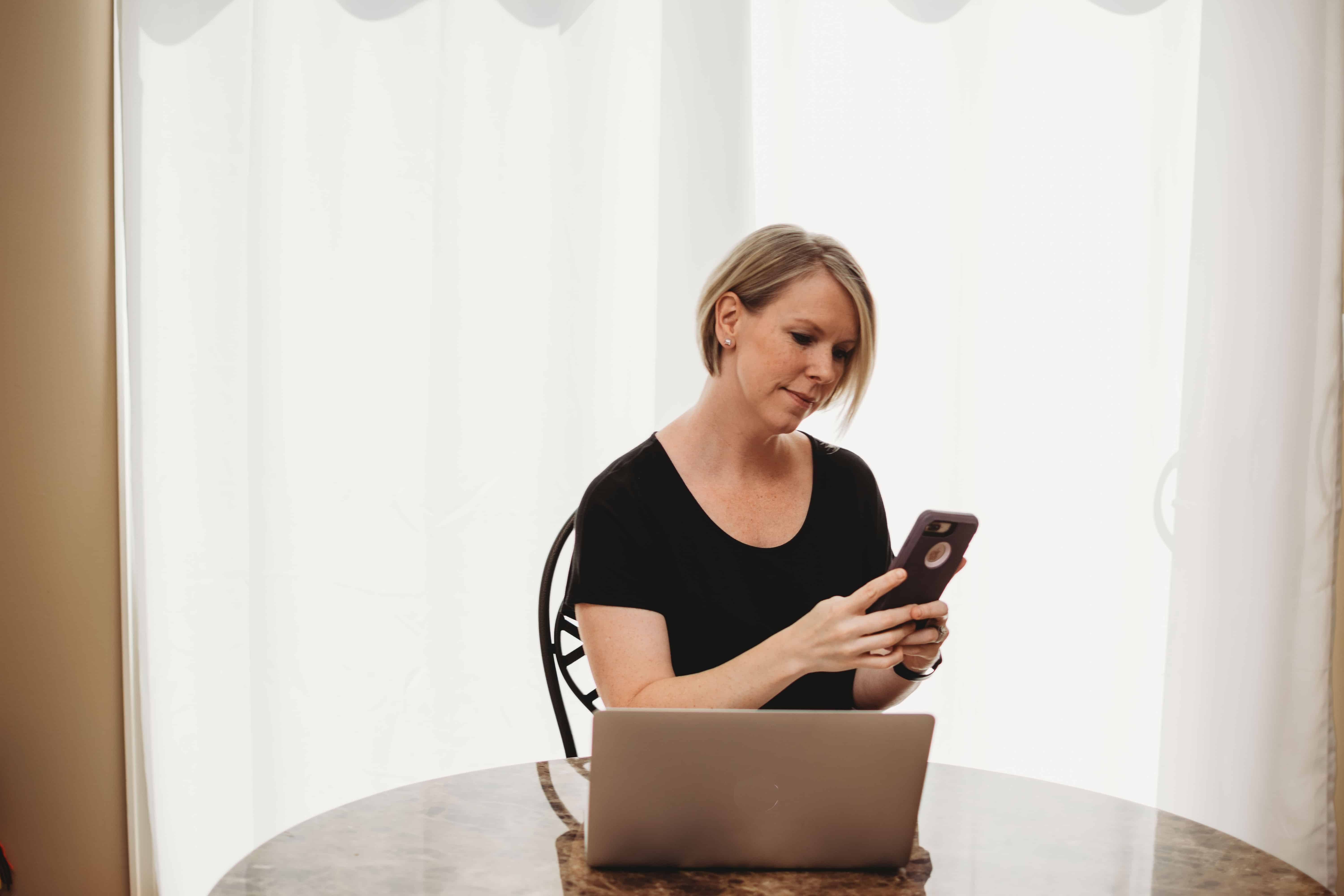Woman using cell phone for two factor authentication cyber security