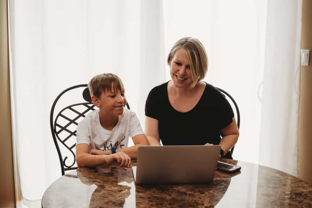 Mom and son using computer while being safe online