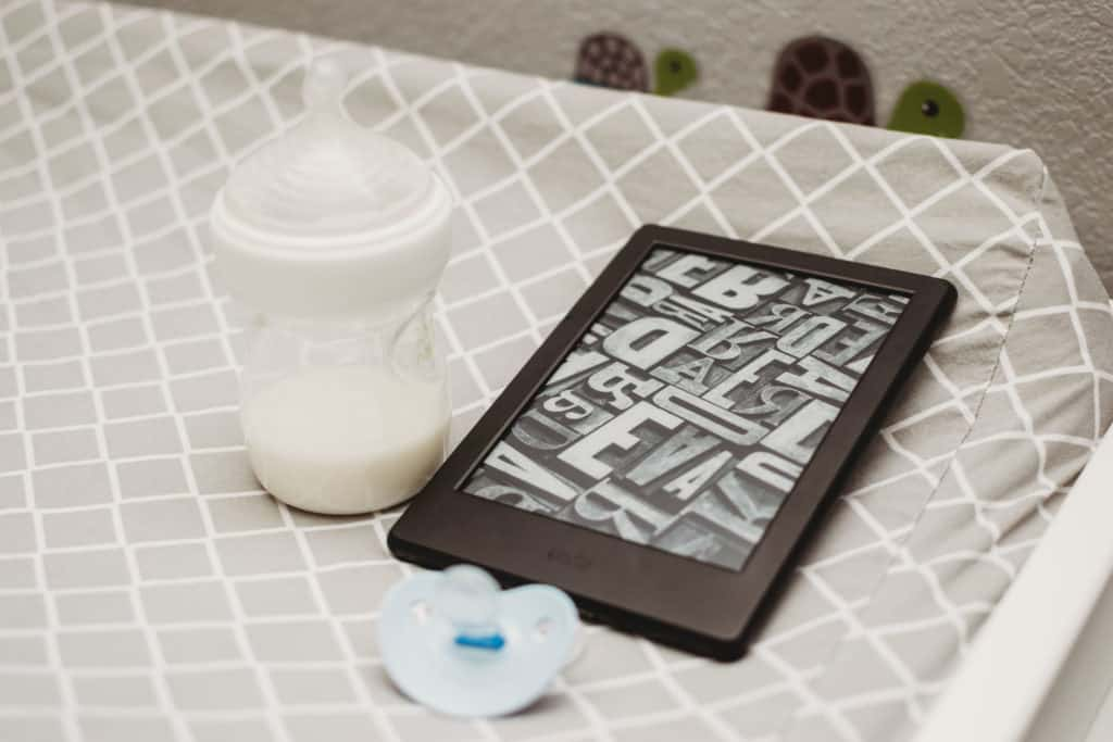 kindle with baby bottle and pacifier