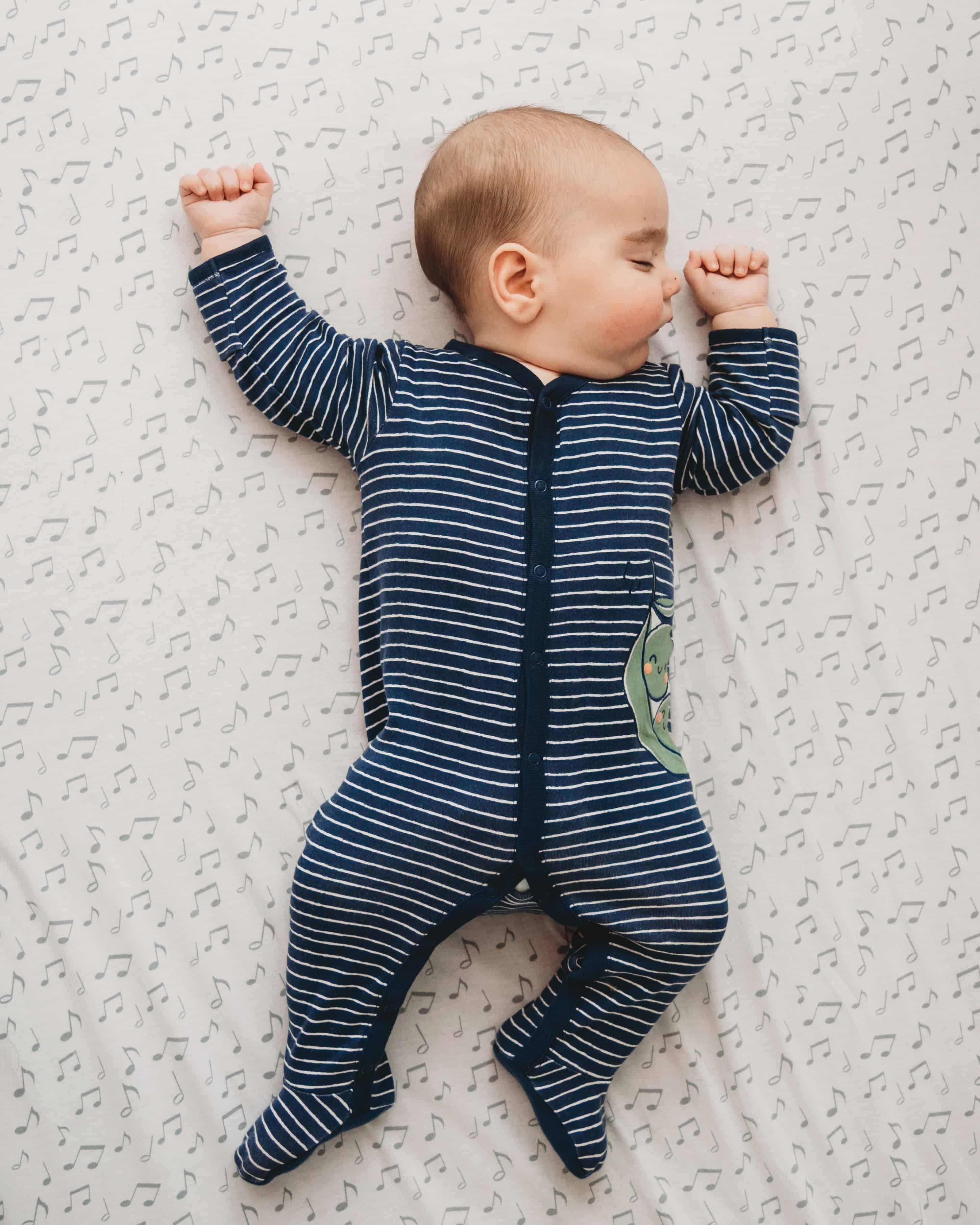 baby boy sleeping in crib