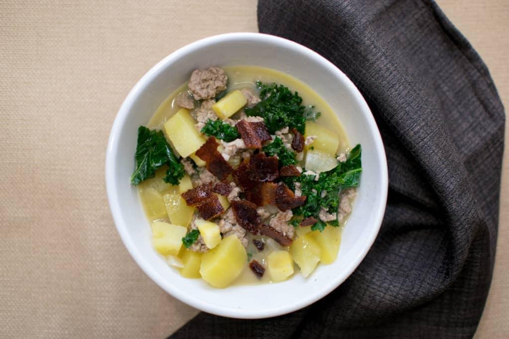Colorado lifestyle blogger, Amanda Seghetti, shares a Paleo Zuppa Toscana recipe. The recipe is Whole30 Compliant! Check it out!