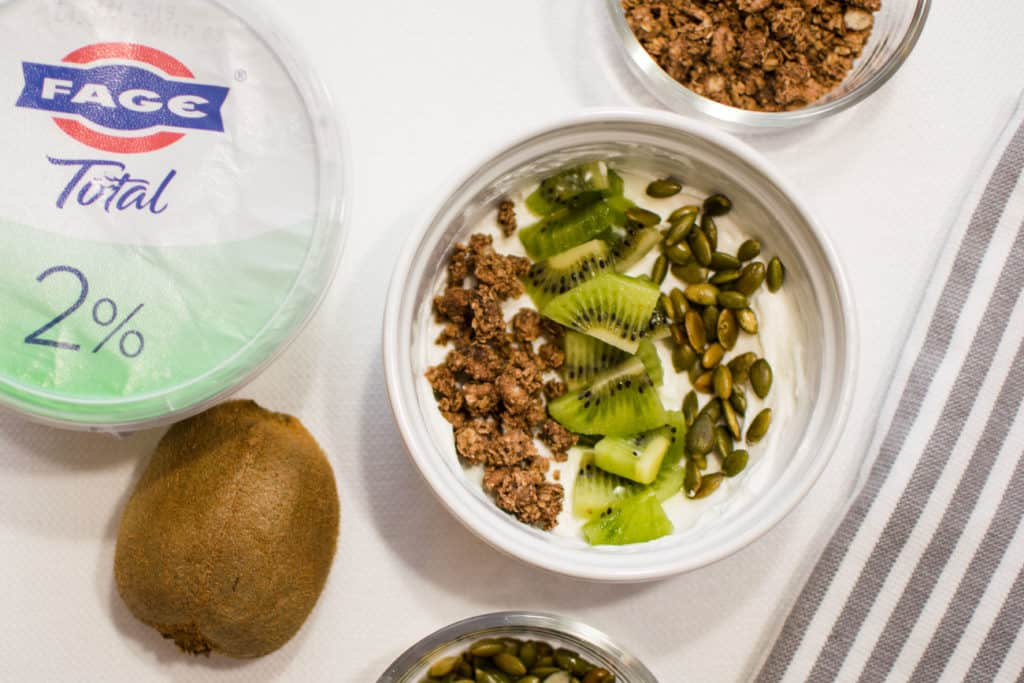 FAGE 2% yogurt bowl with kiwi granola and pumpkin seeds