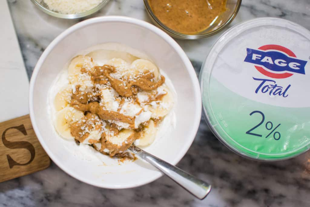 FAGE 2% yogurt with almond butter banana unsweetened coconut