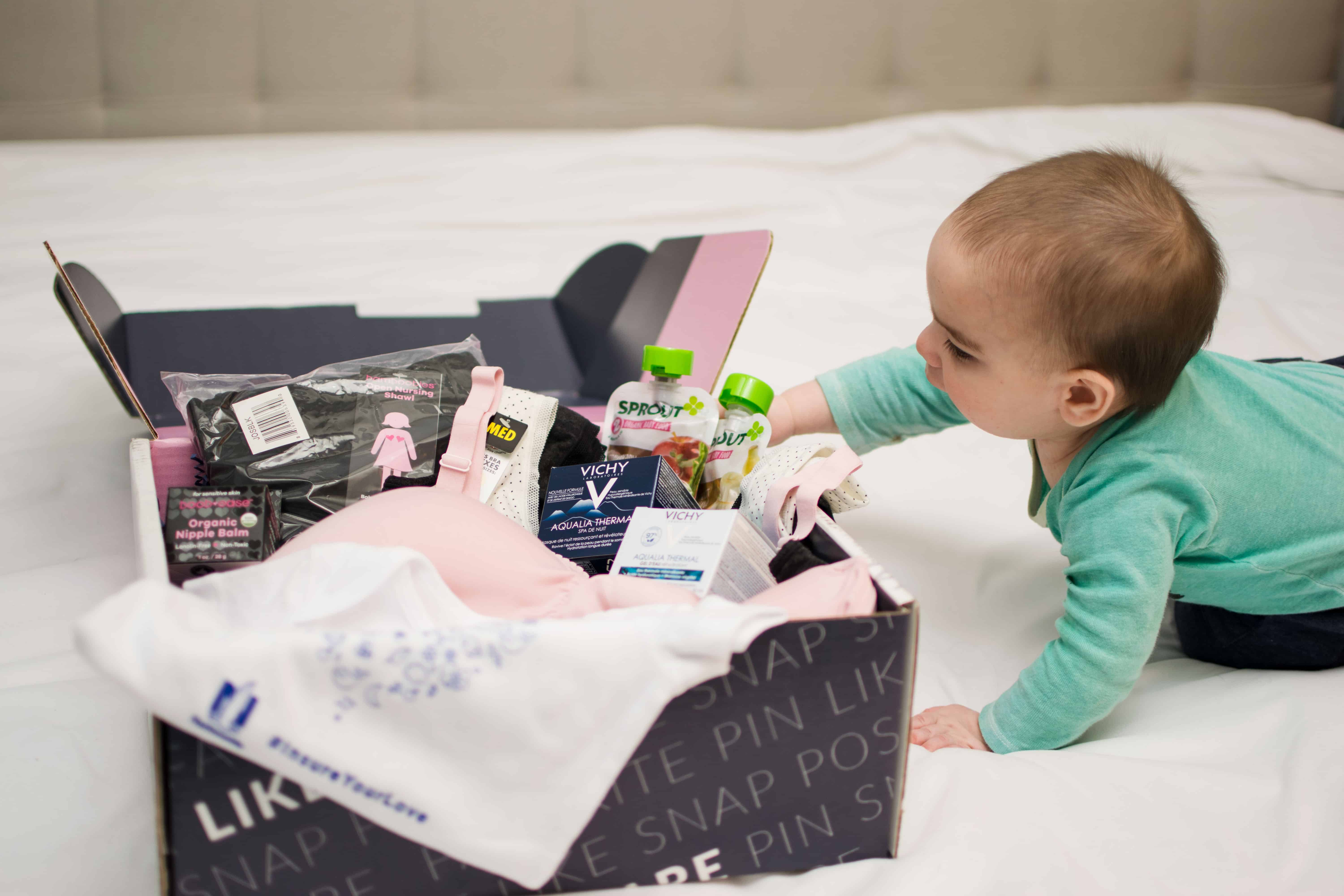 Baby reaching for New Mom Essentials in Babbleboxx