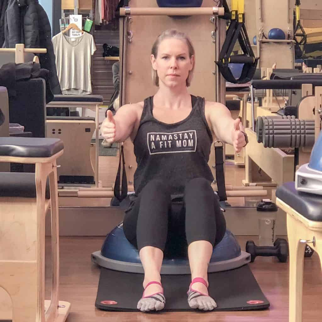 Momblogger Amanda Seghetti does abdominal exercises on Bosu at Club Pilates
