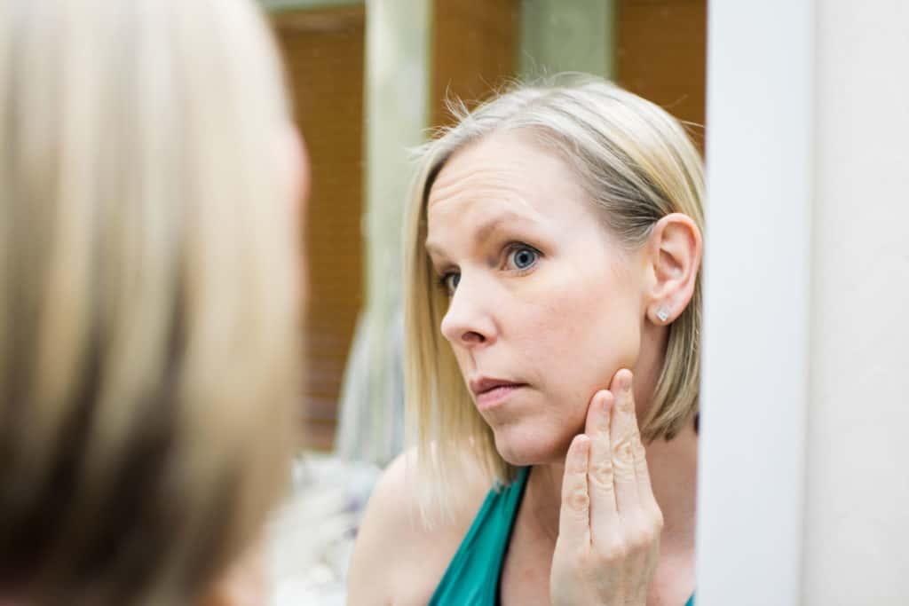 38 year old woman checking facial skin for cancerous spots | Amanda Seghetti