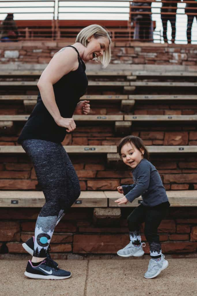 Mom and toddler exercising together at Red Rocks Amphitheater to reduce risk of cancer | Amanda Seghetti