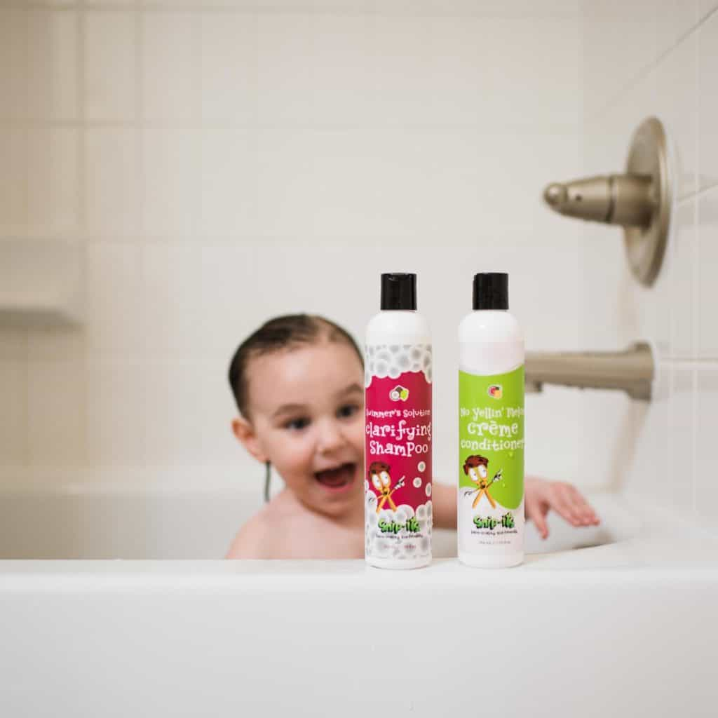 Toddler washing hair with Snip-Its shampoo and conditioner
