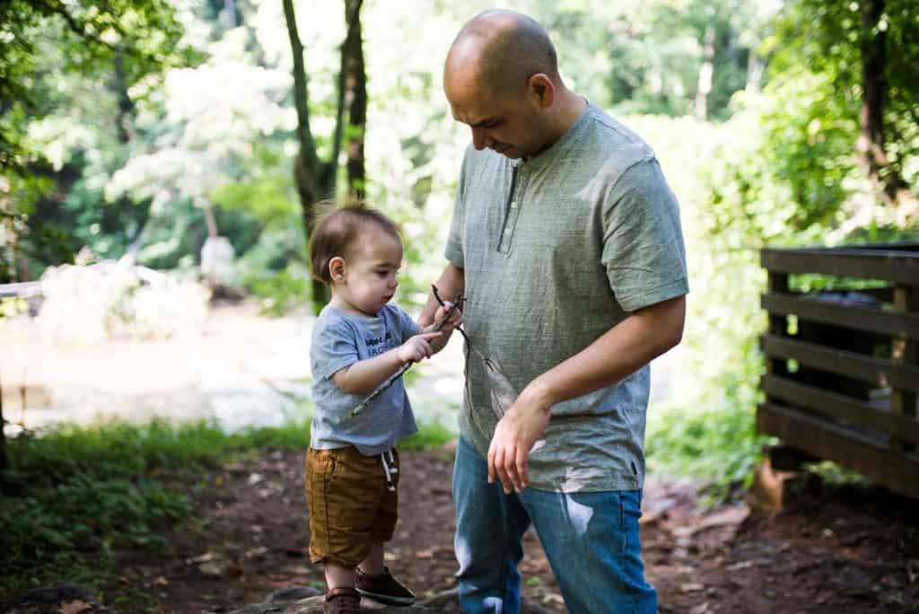 Dad playing with son at Vickery Creek Trail in Roswell, Georgia