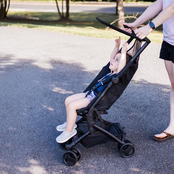 The canopy of the Clutch Stroller by Delta Children provides shade from the sun.