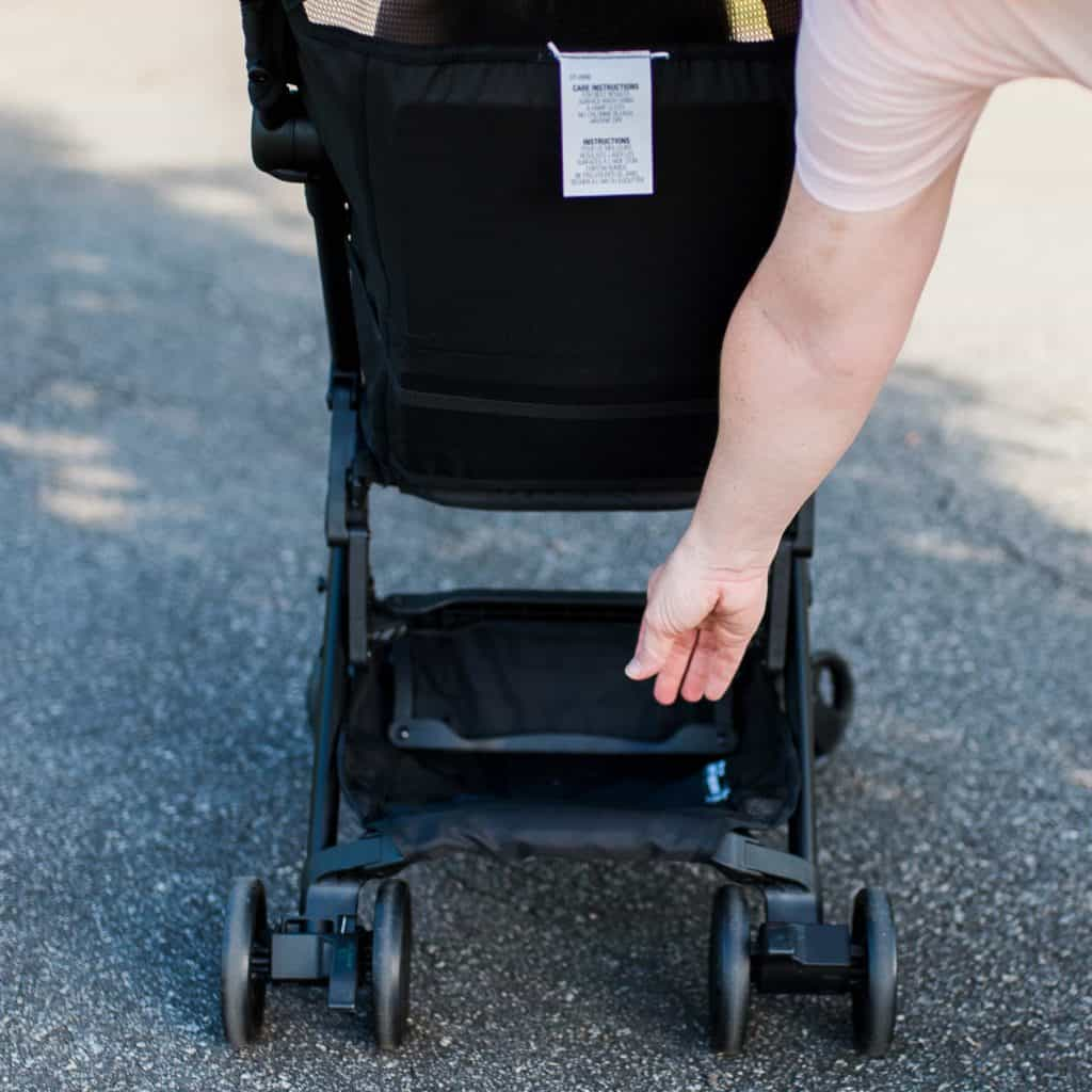 Lifestyle blogger Amanda Seghetti demonstrates the storage space of the Delta Children Clutch travel stroller