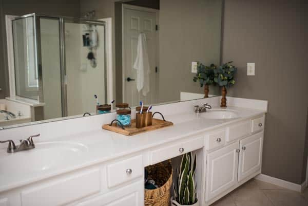 wood accents and greenery in master bathroom decor