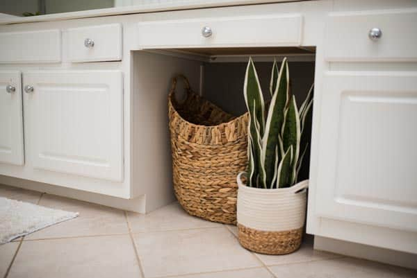 Easy master bath remodel with wicker basket and greenery