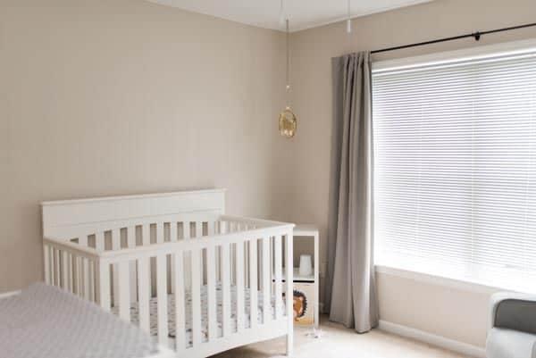 White crib in gender neutral nursery