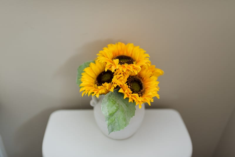 white vase of faux sunflowers