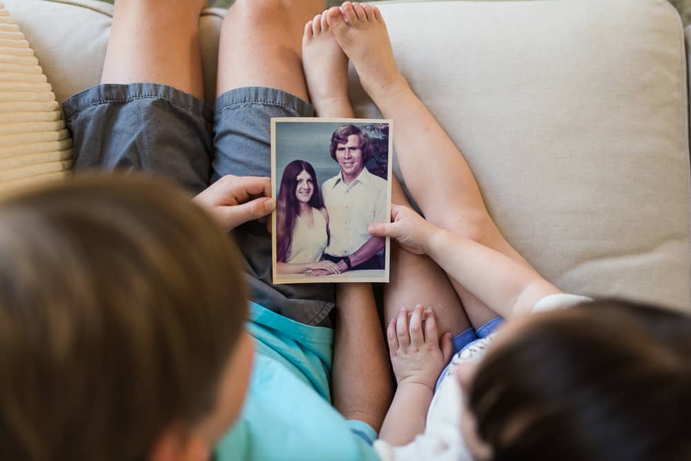Children looking at photo of deceased grandparents