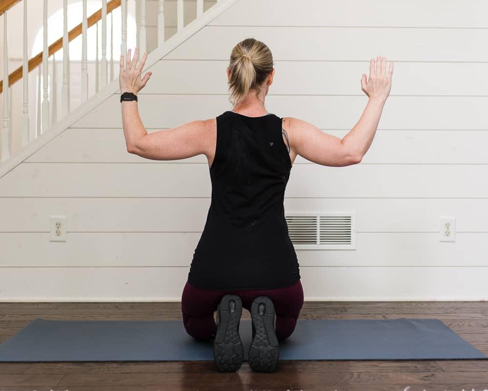 Lifestyle blogger Amanda Seghetti demonstrating scapular retraction