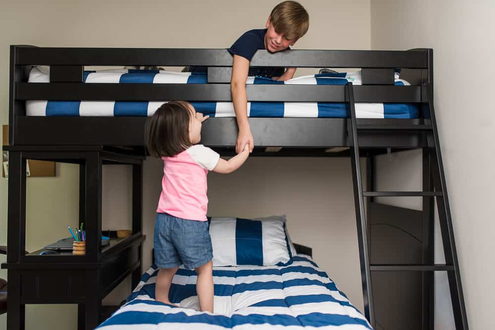 brother and sister playing on bunk beds