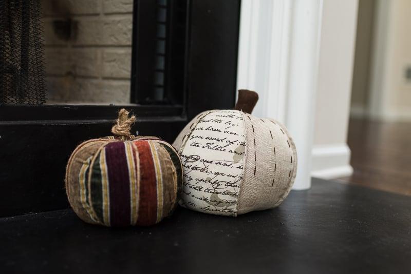 cloth fabric pumpkins beside fireplace
