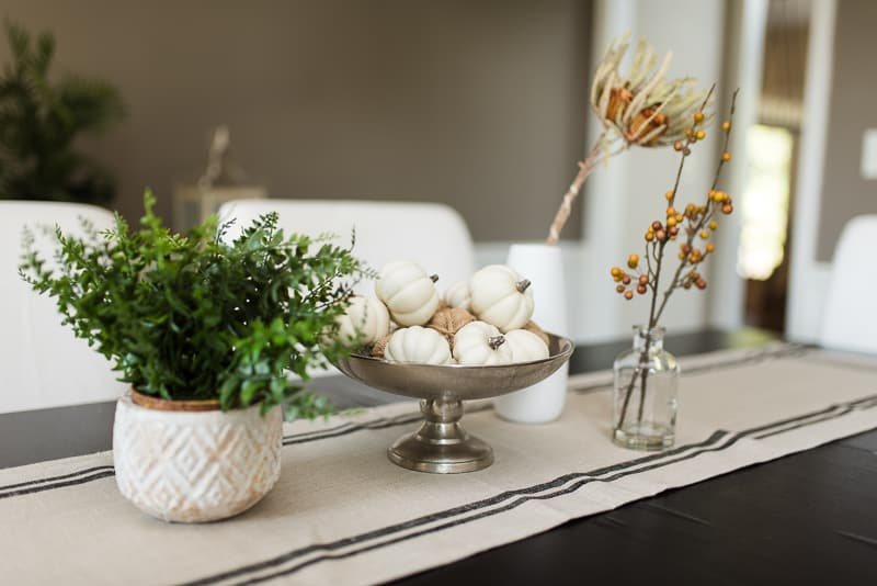 simple fall tablescape with neutral decor and greenery