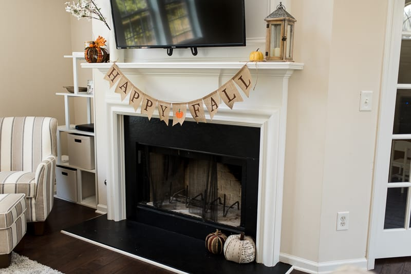 Minimal decor for farmhouse fireplace and mantel