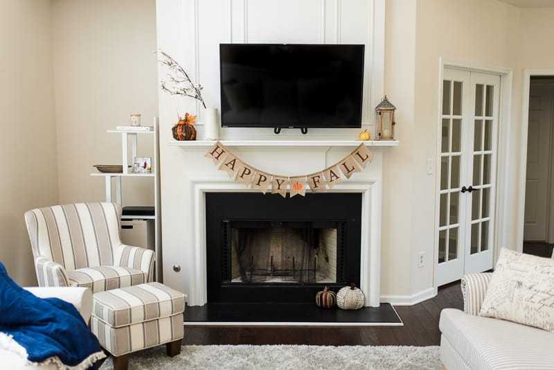 Farmhouse living room fireplace fall decor