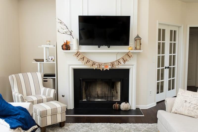 Farmhouse living room fireplace fall decor