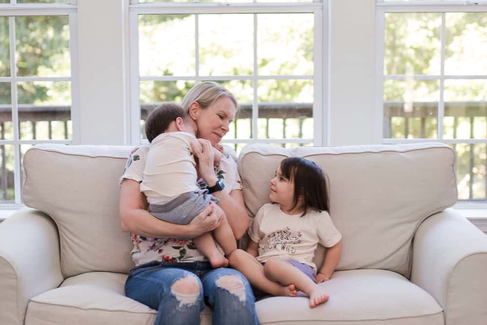 lifestyle blogger Amanda Seghetti on couch with babies