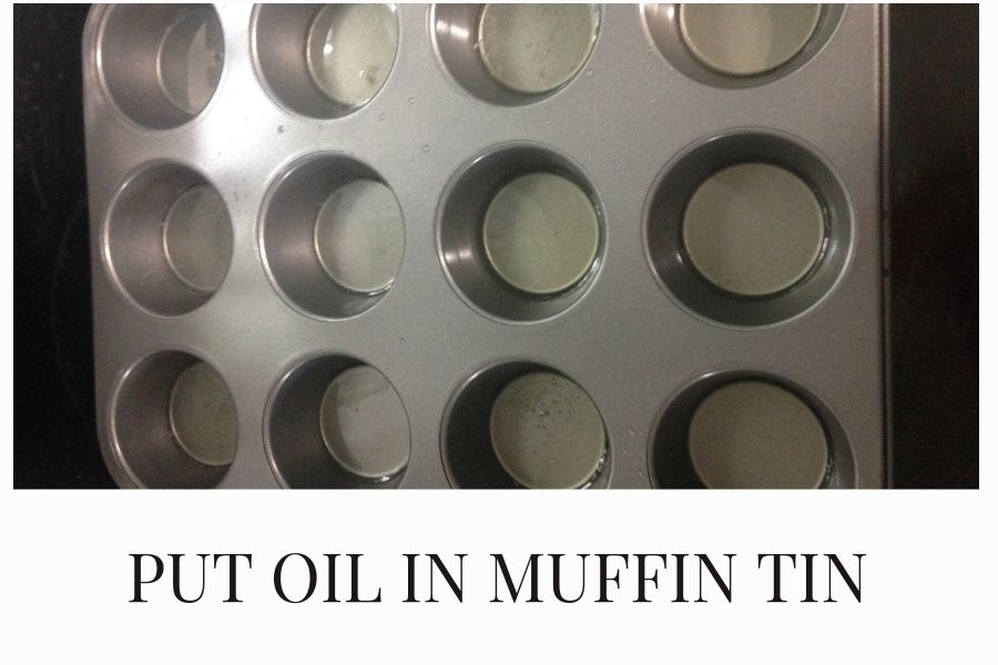 Heat oil in muffin tin until sizzling