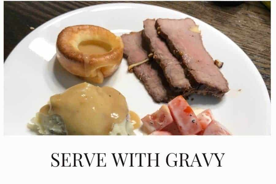 Serve Yorkshire Pudding with gravy alongside Roast beef for the perfect meal combination!