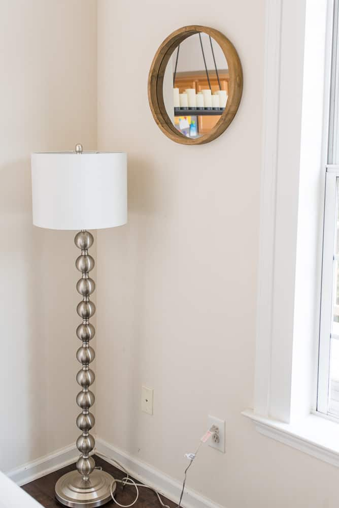 steel lamp and rustic round mirror
