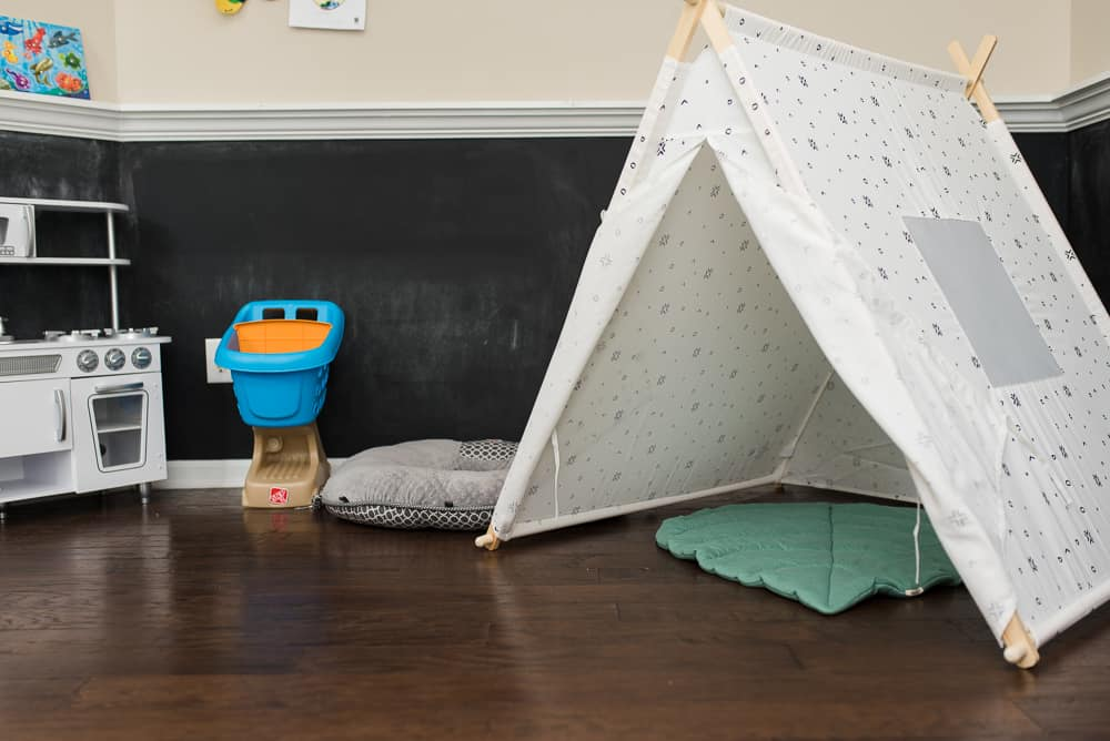 toddler playroom with tent and kitchen