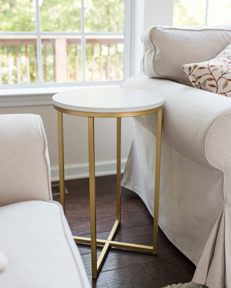 white side table with gold colored legs