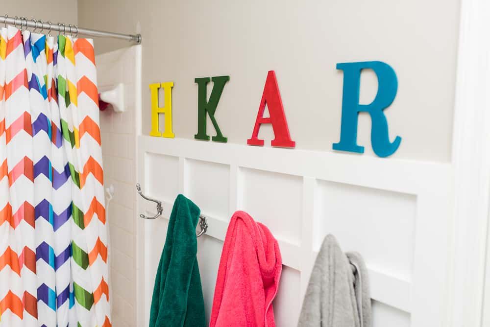 Letters to organize bathroom towels