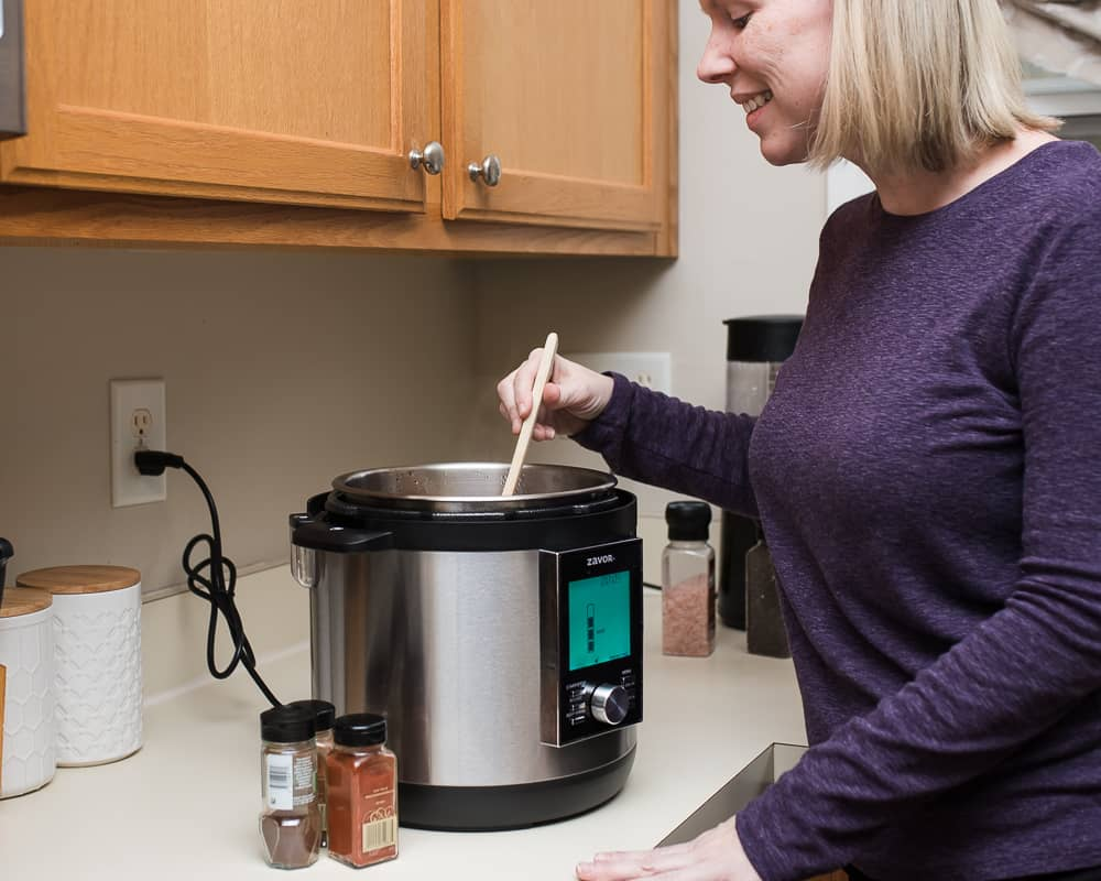 Lifestyle Blogger Amanda Seghetti using multicooker to make paleo chili recipe